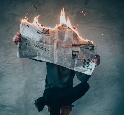 Man with burning newspaper