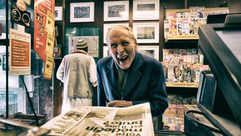 Laughing newspaper man
