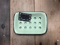 Green enameled metal soap dish