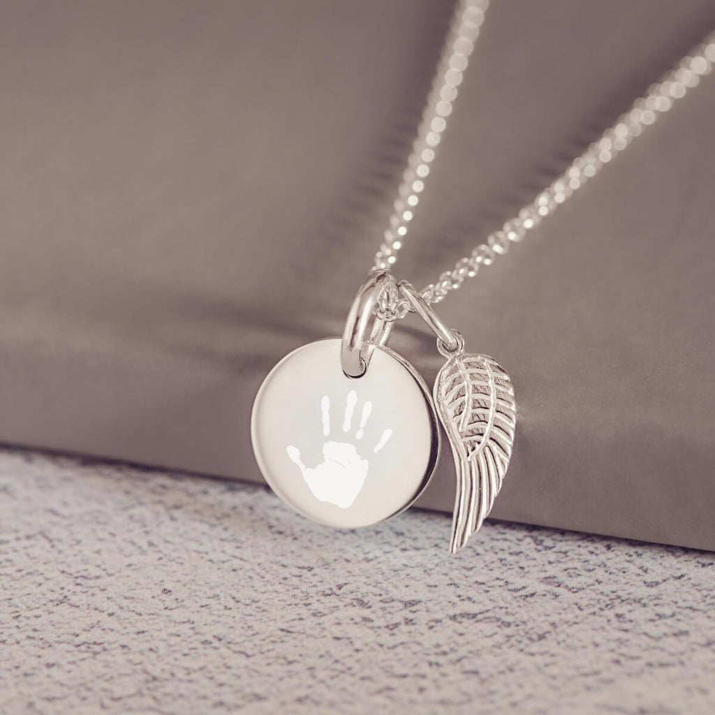 b348c3d65 Engraved Handprint Or Footprint Round Charm Necklace With Angel Wing C –  Hand on Heart Jewellery