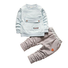 Light Blue Long Sleeve and Grey Pants