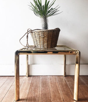 Glass and Brass Tone Side Table