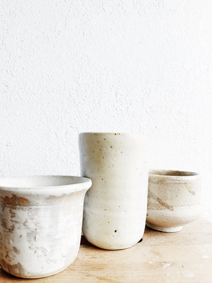 A Trio of Creamy White Pottery