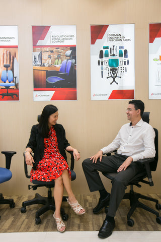 Evonne Ng (left) discussing ergonomic matters with Dc Andre (right) in Ergoland Penang branch