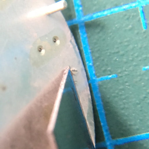 using a penknife to remove the protruding dial legs