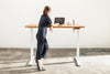 Woman standing at a height adjustable wood desk