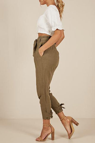 khaki slim fit cigarette pants with high waist belt and tied ankle strap detail