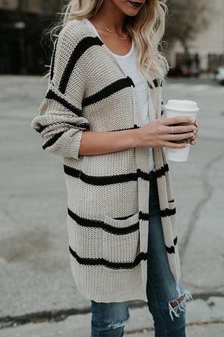 white and black striped longer length cardigan knitwear with pockets