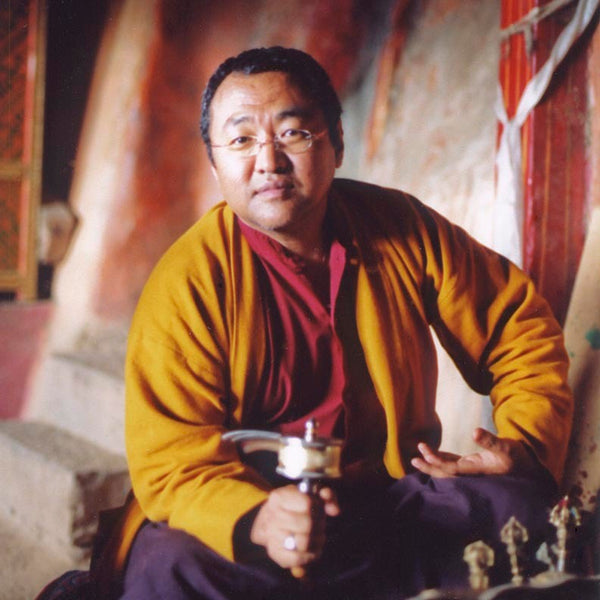 Jigme Tromge Rinpoche with Prayer Wheel Photo