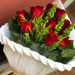 A Wrapped Bouquet of Red Roses
