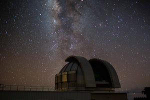 Telescope gazes at a star filled sky