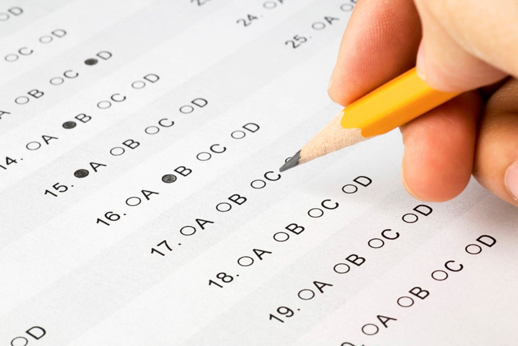 Multiple choice admissions test with a few answers filled using a pencil