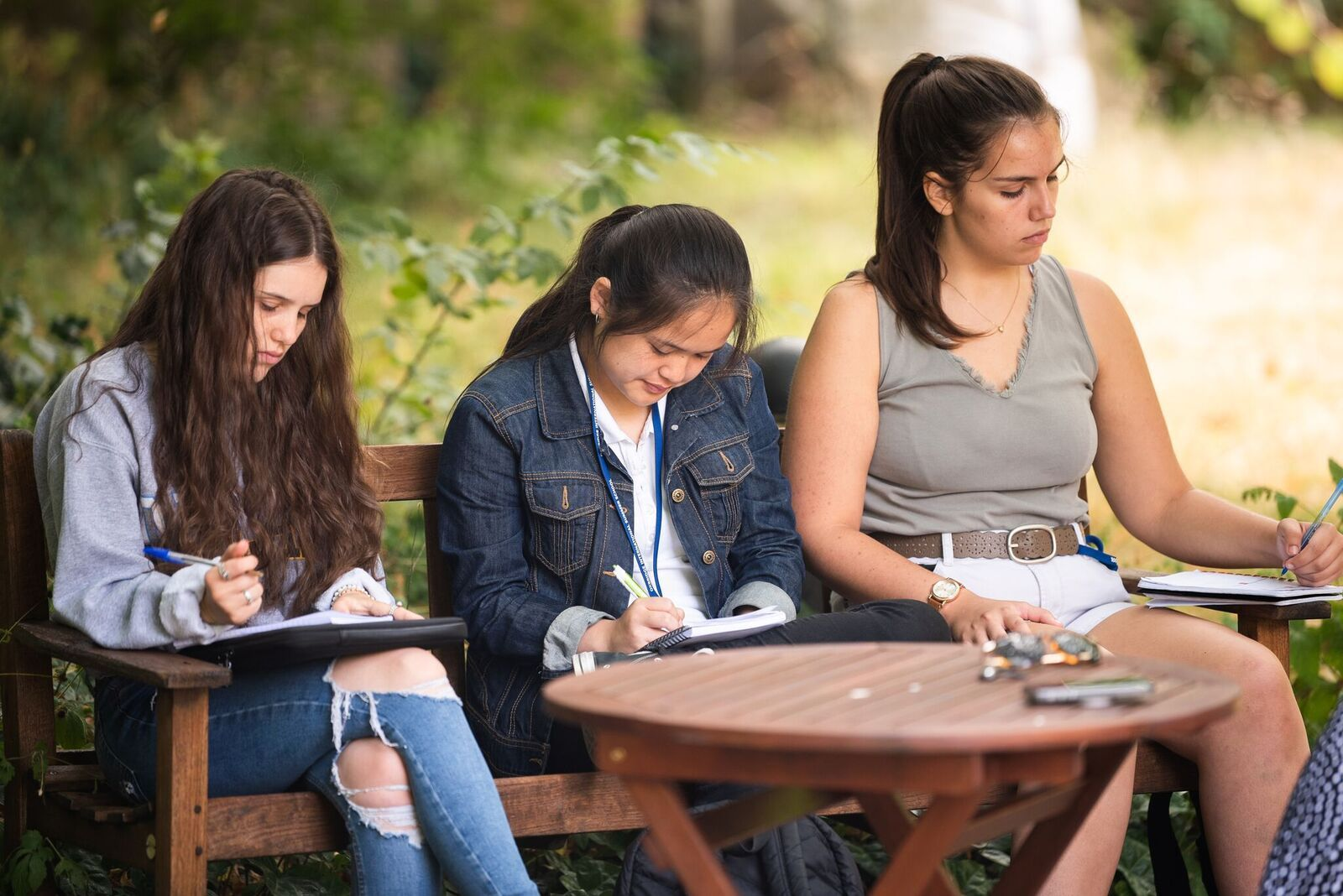 3 students work outside to prepare for their Oxford or Cambridge interviews