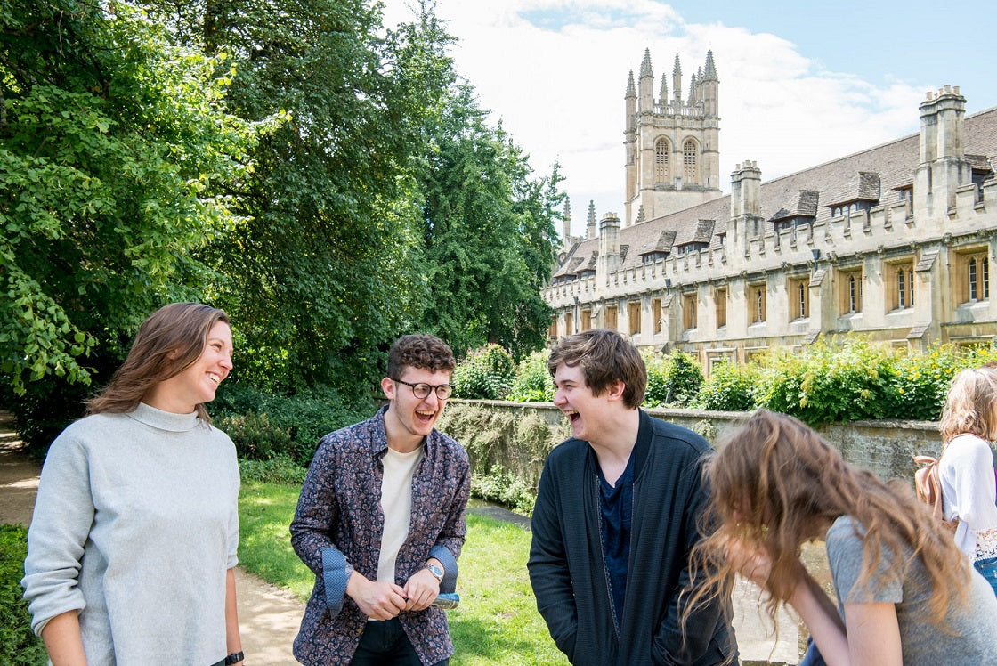 Students socialise in the ground of and Oxford College, taking a break for interview preparation