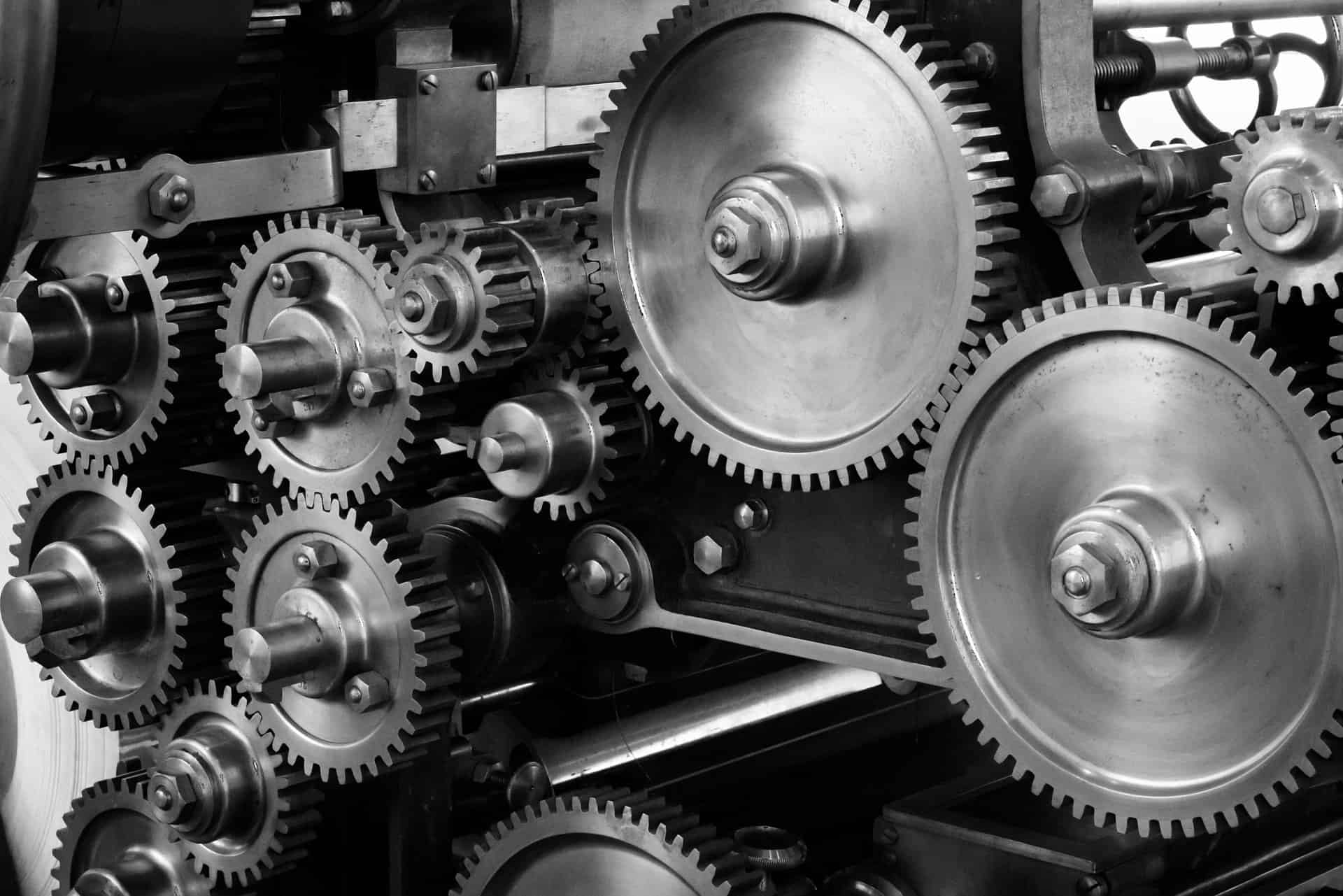 A black and white image of gears turning - you will explore engineering at Oxford and Cambridge