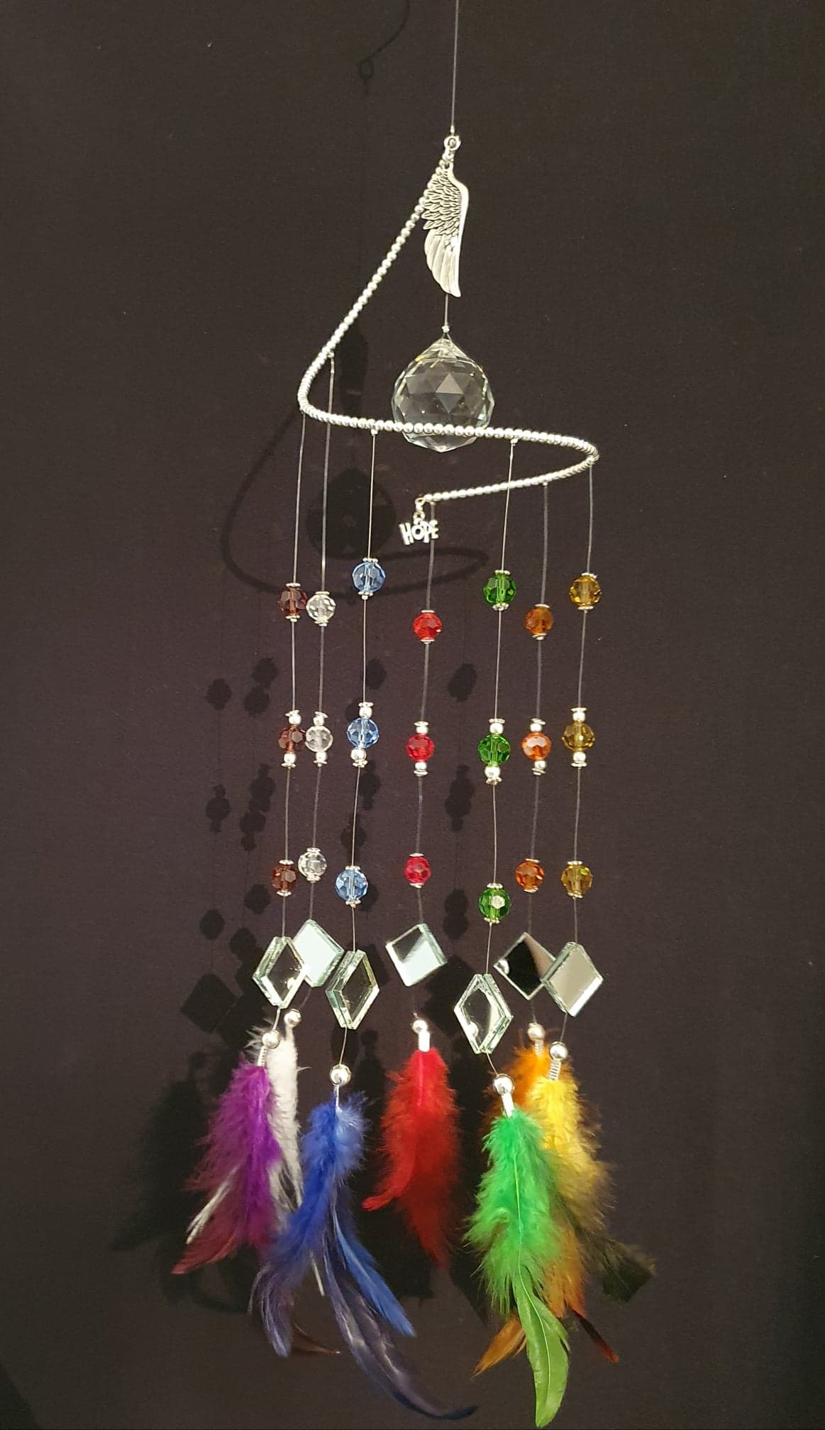"Rainbow suncatcher of ""HOPE"" with matching colour feathers. Large Angel wing."