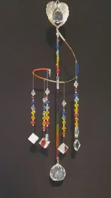 Beautiful Rainbow/Chakra theme spiral suncatcher with Angel Wing heart