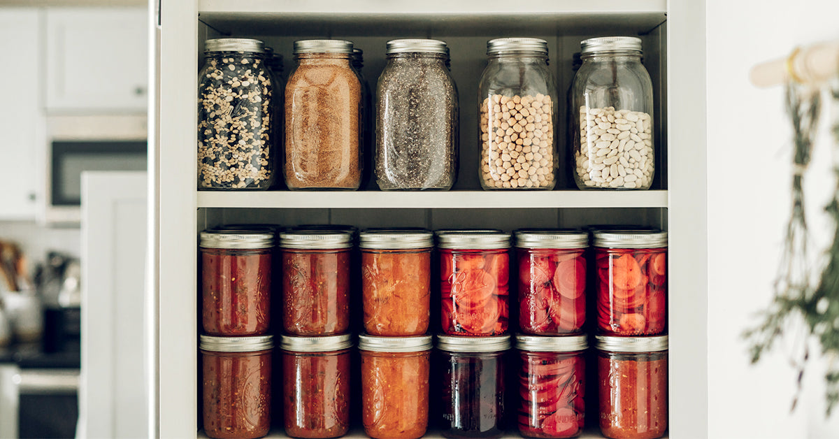 Jarred foods and seeds sitting in shelves on a pantry