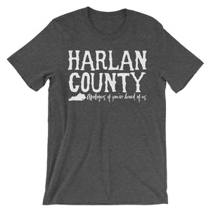 Dark grey heather tee with vintage distressed print with the words Harlan County apologies if you've heard of us.