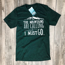 Green shirt with the words The Mountain are calling and I must go.
