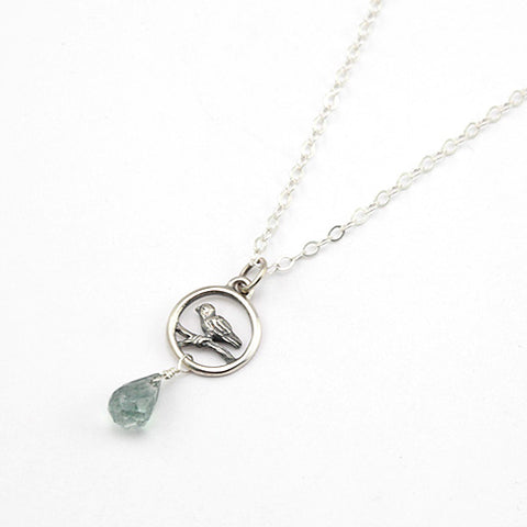 bird in circle necklace