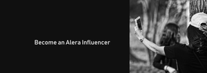 Black and white image of two girls, one girl holding up a cell phone taking a picture of herself with the words become an alera influencer