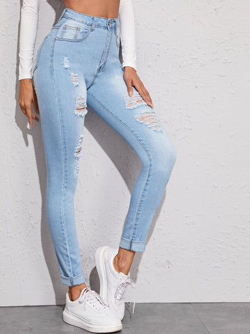Ripped Washed Button Fly Jeans