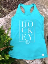 Ladies' teal tank with HOCKEY written in white