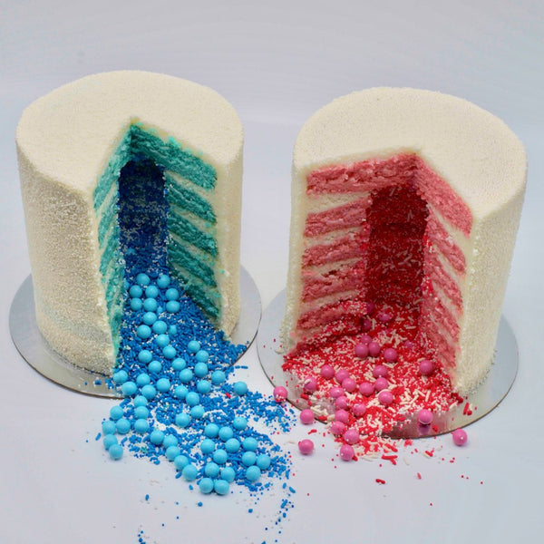 2 cakes - one with 6 pink and another with 6 blue layers, cream cheese frosting, decorated with nonpareils and contain a sprinkle surprise in the center.