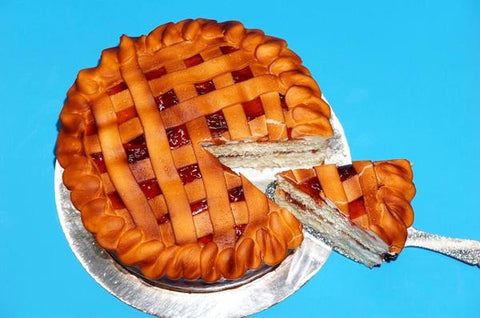 Cake decorated to look like an apple pie with slice cut out