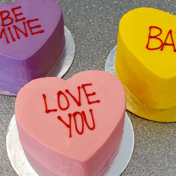 Red blue and yellow heard shaped cakes with conversation phrases