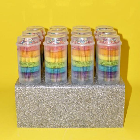 12 rainbow cake push-pops in glitter acrylic stand