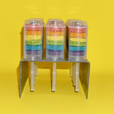 12 rainbow cake push-pops in glitter acrylic stand from side