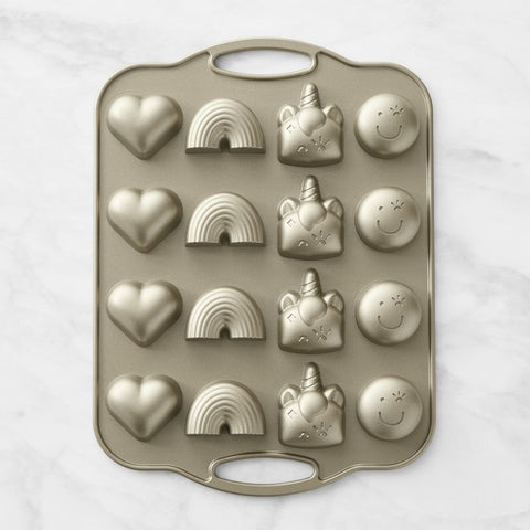 Cast-aluminum pan with 16 cake bites: 4 smiley faces, 4 unicorns, 4 rainbows and 4 hearts