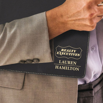 Custom engraved gold on black portfolio branded Realty Executive logo