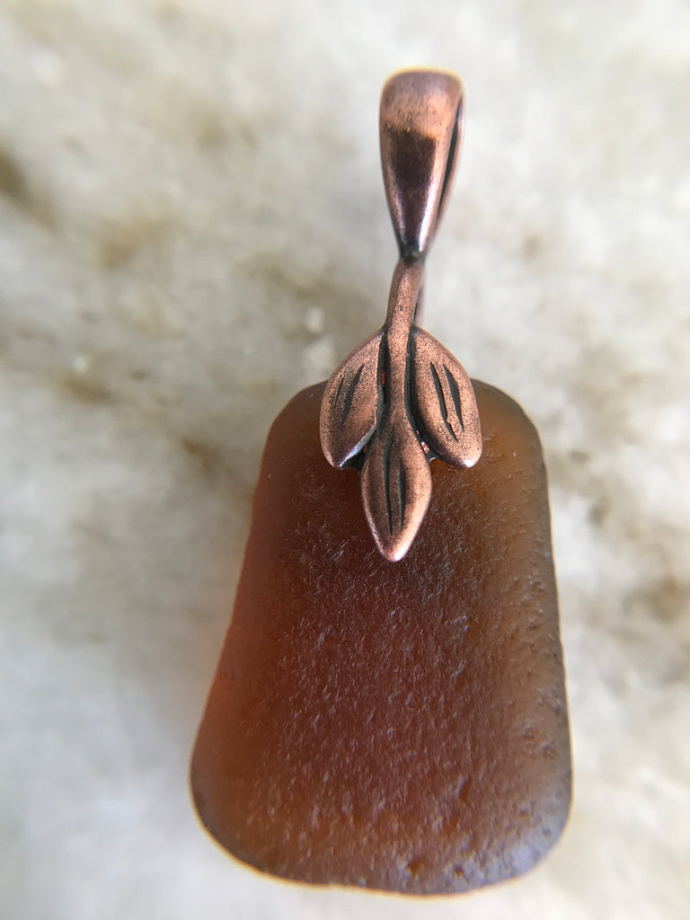 Brown piece of sea glass with copper leaf pinch bail