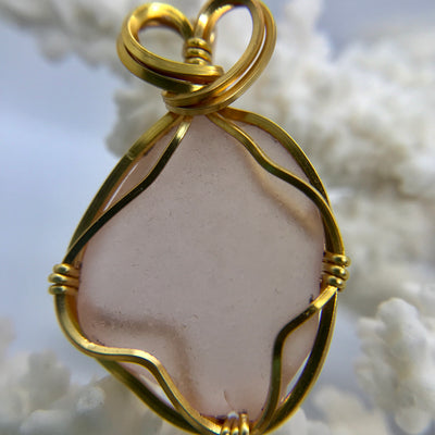 Pink sea glass with gold wire pendant