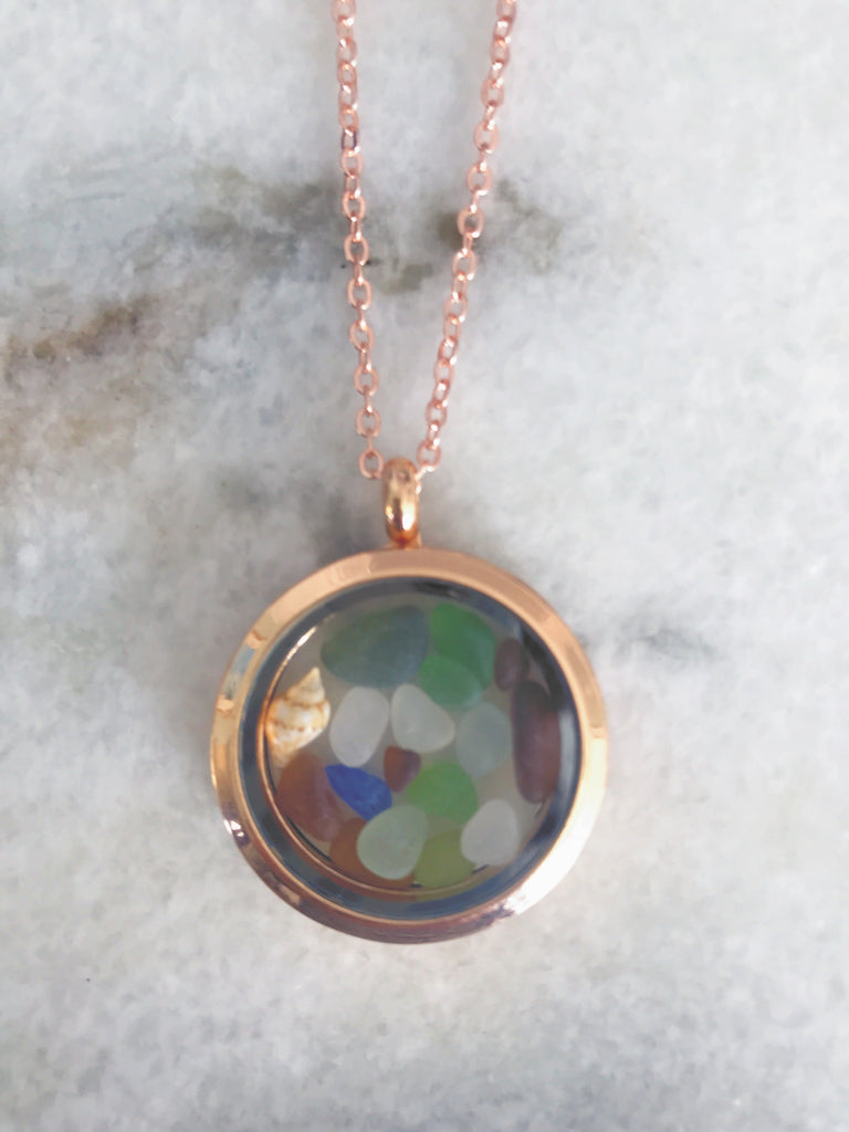 Gold locket with miniature sea glass