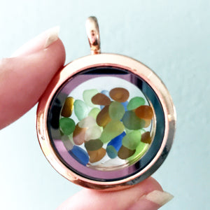 Locket with miniature pieces of sea glass