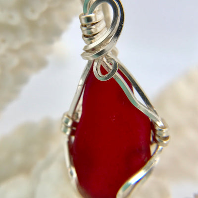 Rare piece of beautiful Red Sea Glass wire wrapped with silver wire.