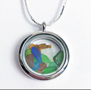 Silver locket with miniature sea glass