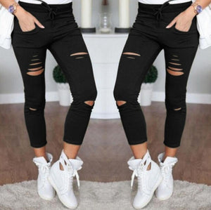 Women's Torn Stretch Denim Skinny Jeans - The Clothing Corp