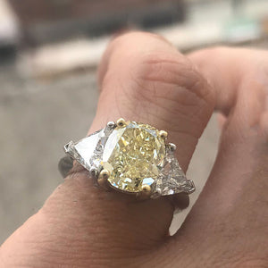 3.7 Carat TW Fancy Light Yellow Oval Diamond Engagement Ring