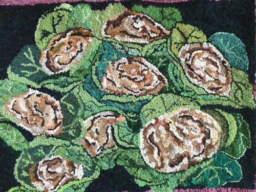 hand hooked rug of cauliflowers in natural, beige and greens