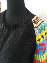 black hand knit pullover with multi color sleeves