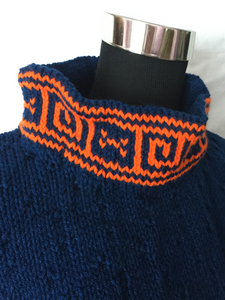 royal blue pullover with orange greek key design
