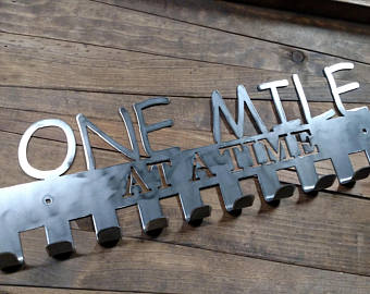 One mile at a time medal display