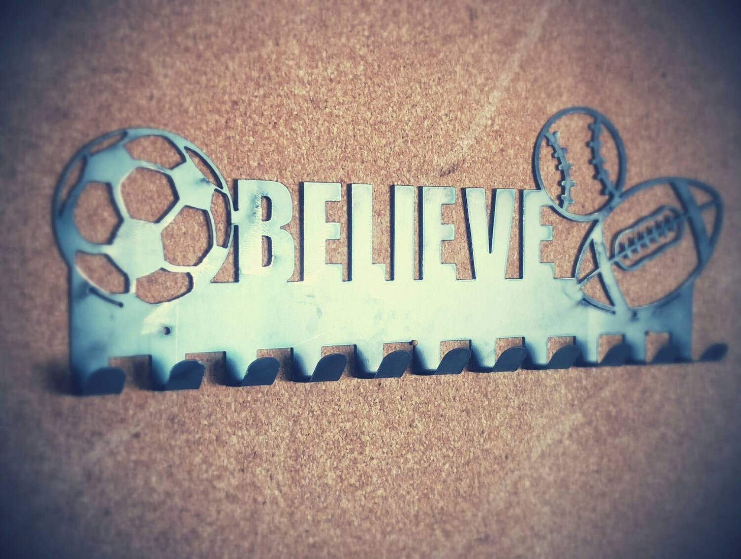 Believe medal hanger with 3 sports