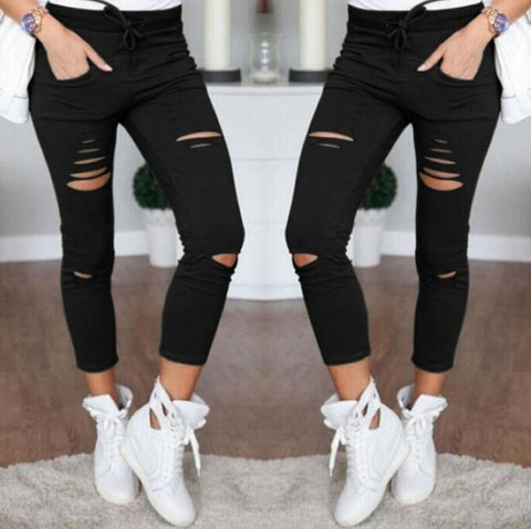 WOMEN'S RIPPED JEANS - Cerenit