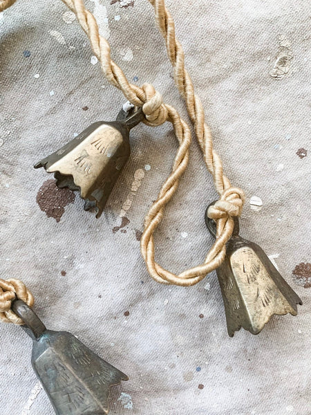 String of Five Incised Brass Bells